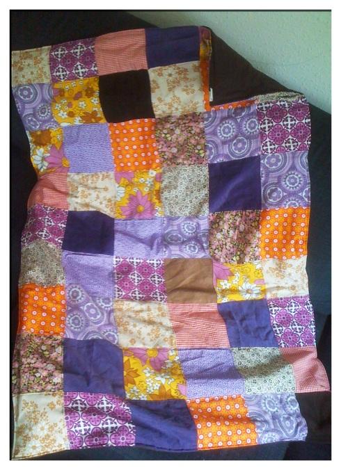Det røde/lilla patchworktæppe