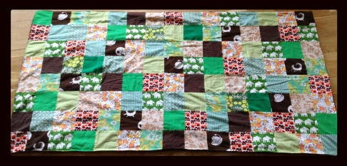 Grønt sengetæppe
