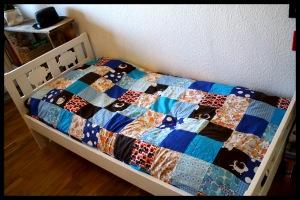 Blåt sengetæppe